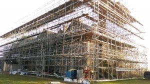 scaffolding structure before the mesh building wrap go up.